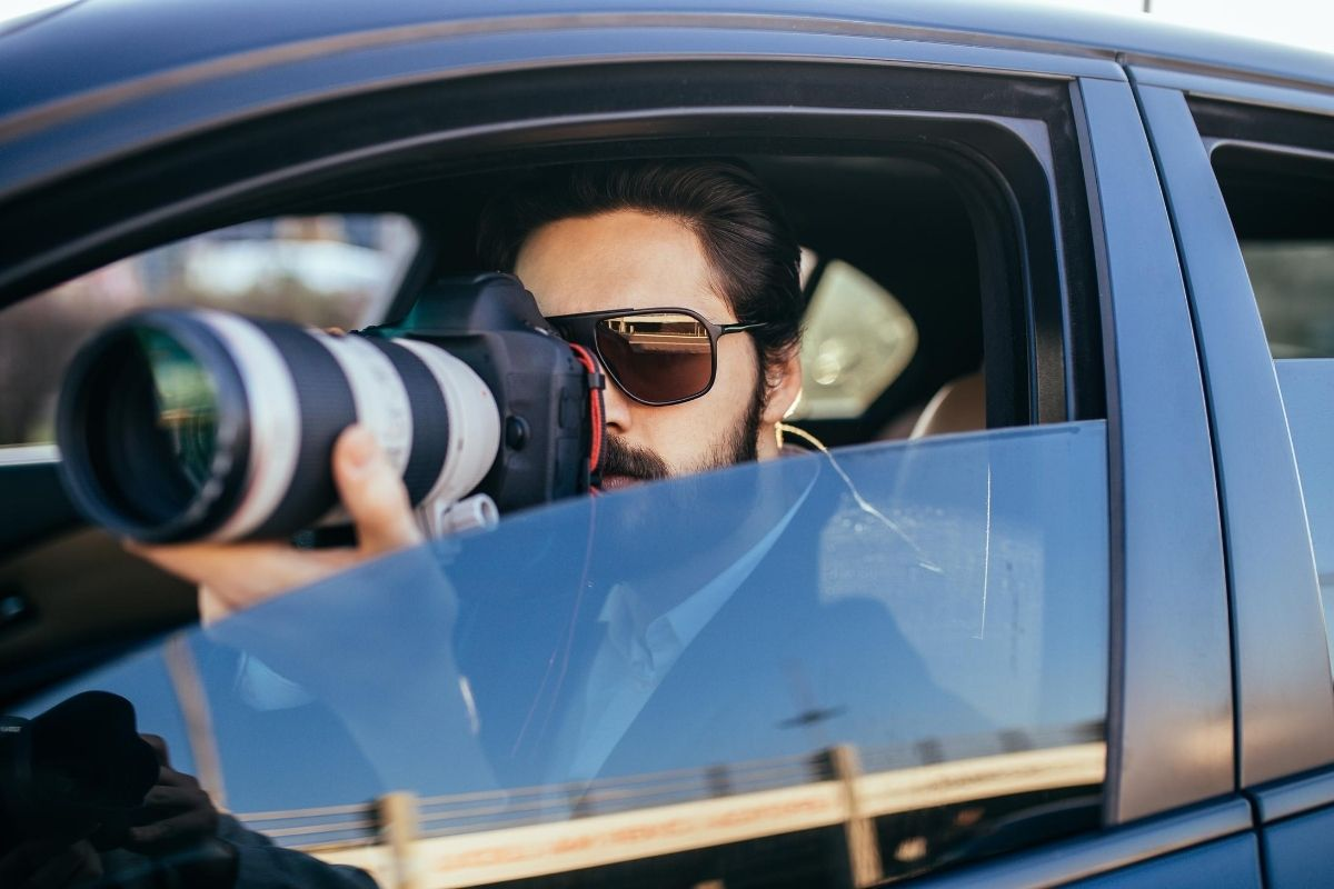 Private Investigator in a car taking pictures