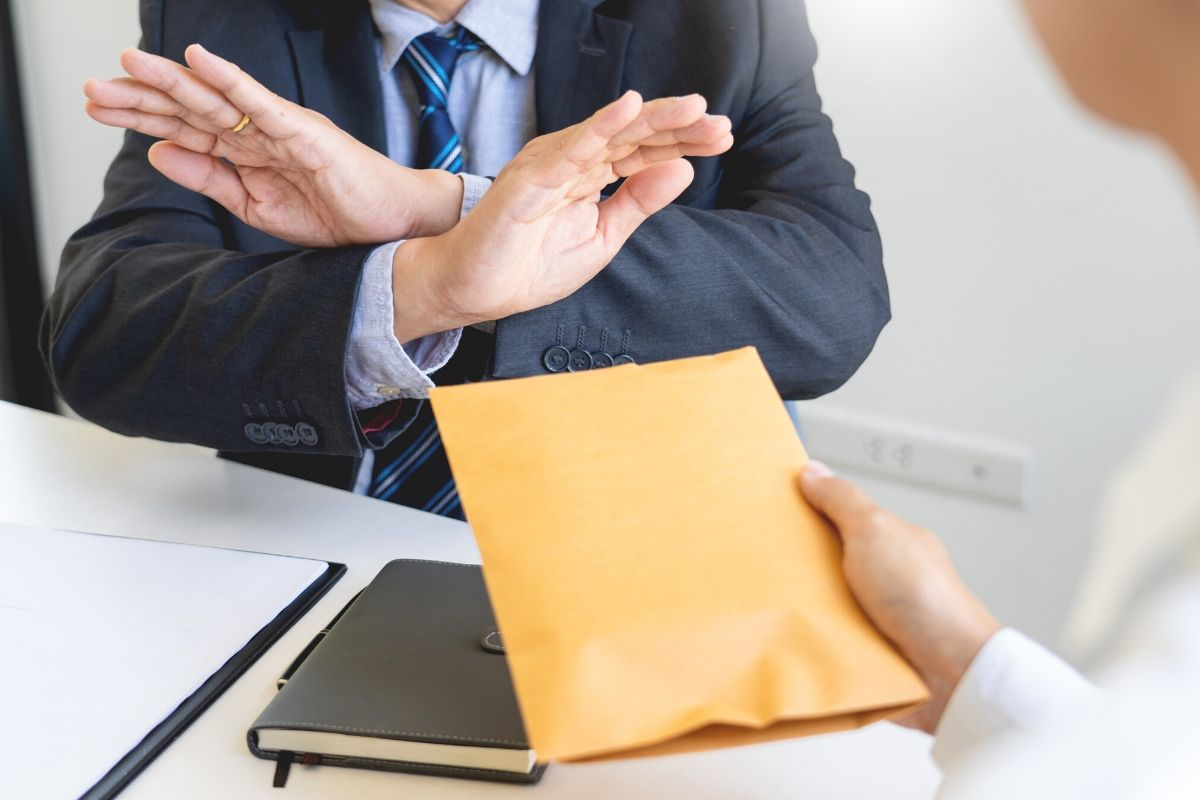 Executive man being served by a process server
